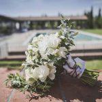 Megan boquette white rose in Tuscany