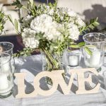 Megan Nicholas table flower setting for their wedding in tuscany