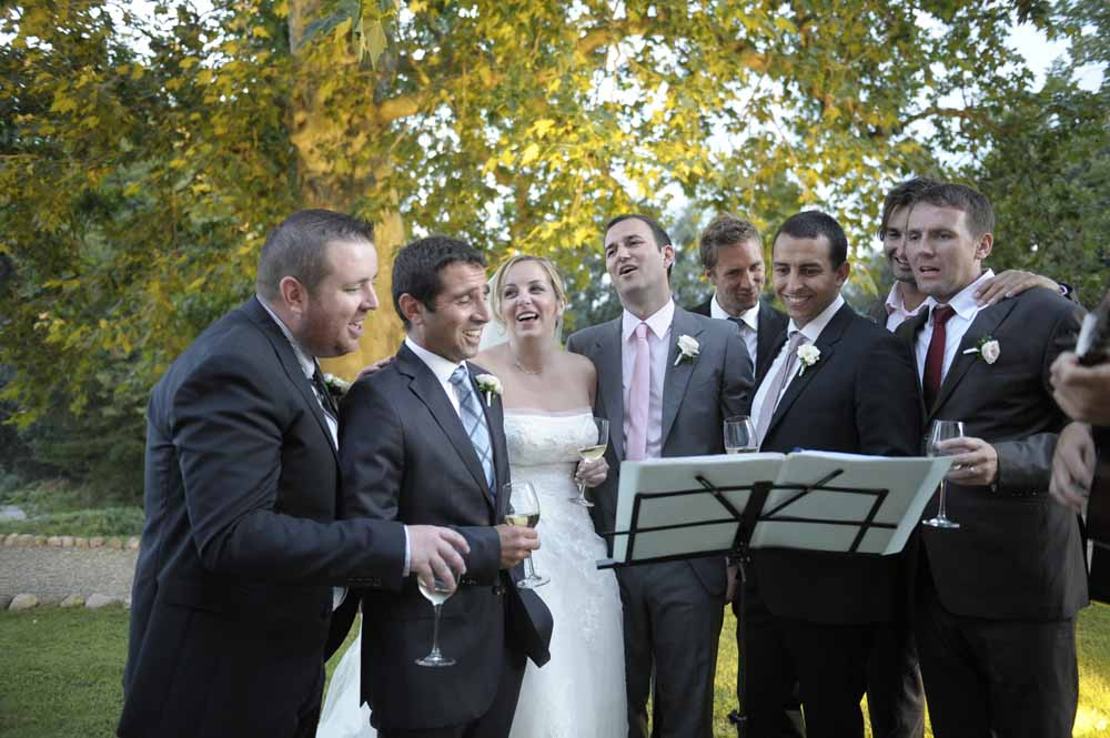 Bride and guests sing during wedding tuscany