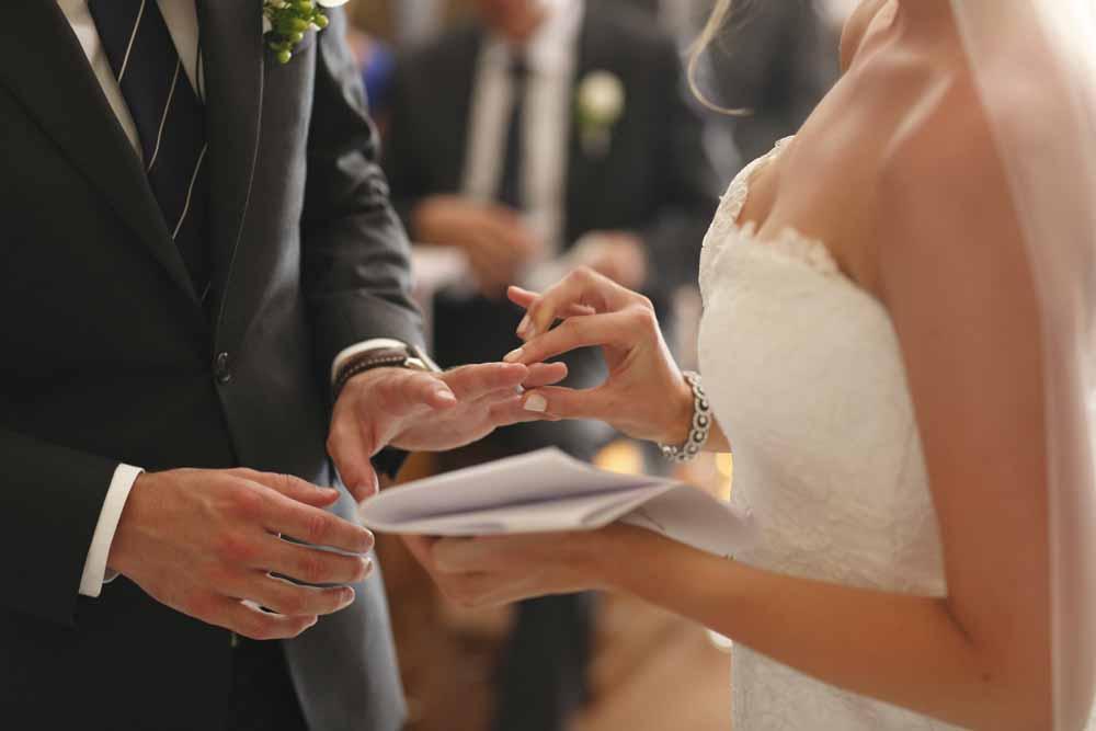 wedding rimgs symbolic ceremony in a tuscan church