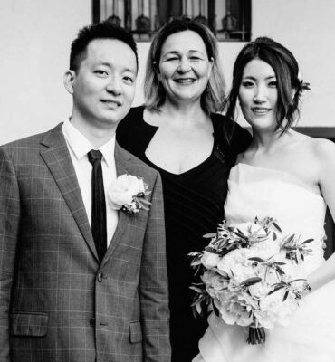 Simona with the bride and groom